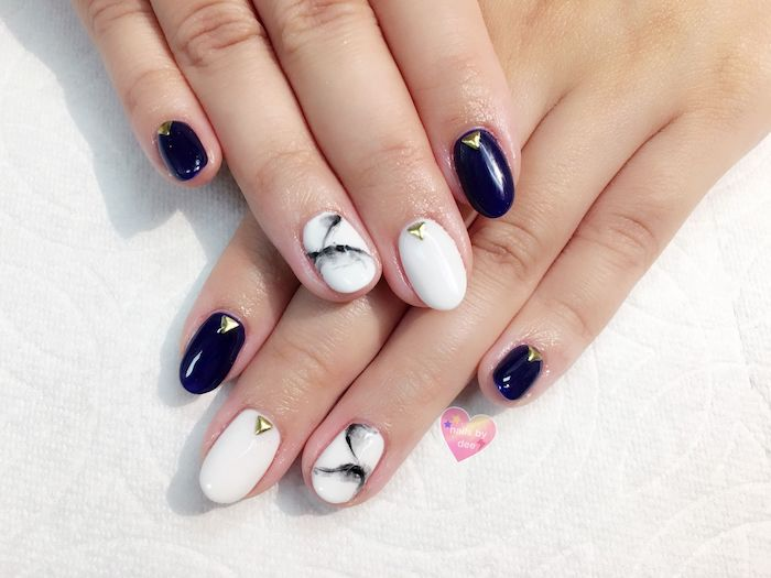 dark blue, white nail polish, nail color ideas, gold rhinestones, black white marble, white background