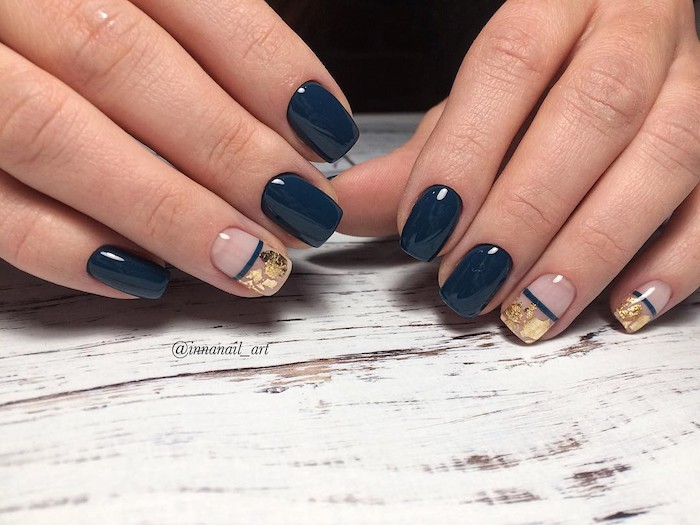 dark blue nail polish, gold glitter, nail decorations, nail color ideas, wooden table, short squoval nails