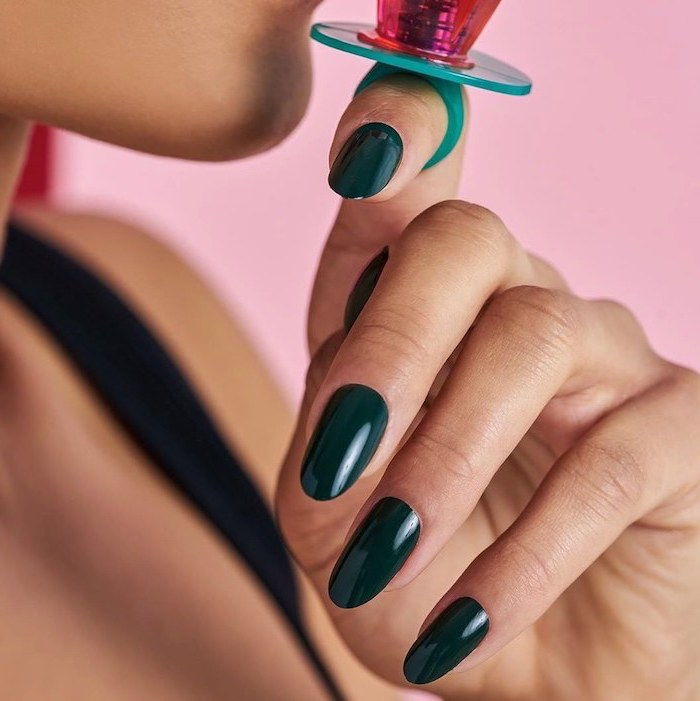 cute nail colors, almond nails, dark green, nail polish, pink background, woman with black top