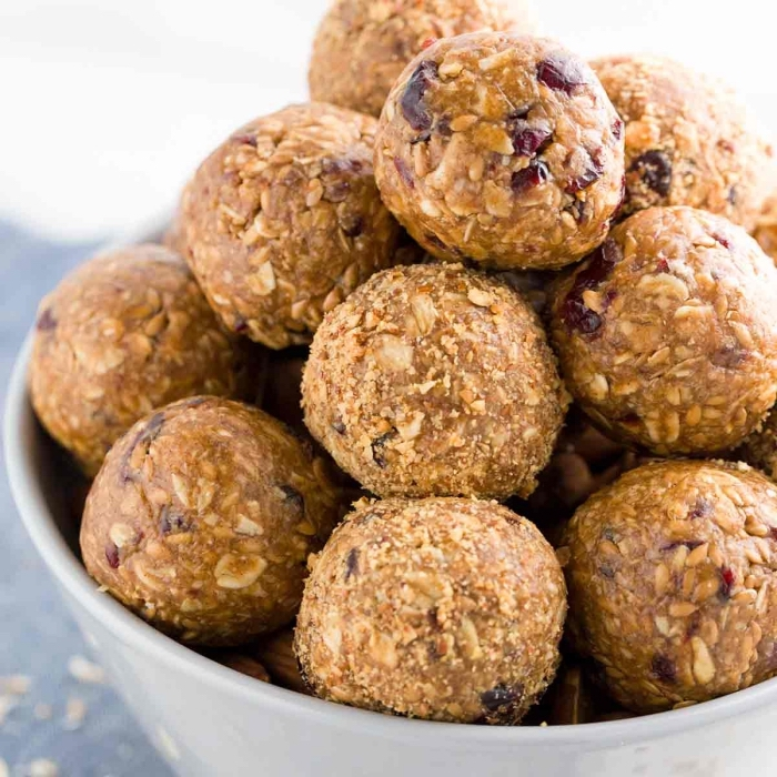 peanut butter, oatmeal and dates, no bake protein balls, in white bowl