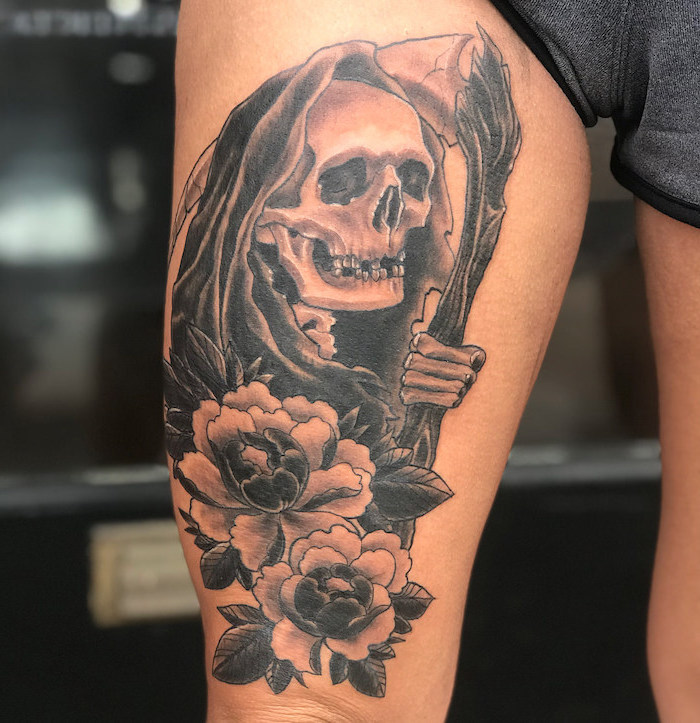 grey shorts, death reaper, skull with flowers, thigh tattoos, blurred background