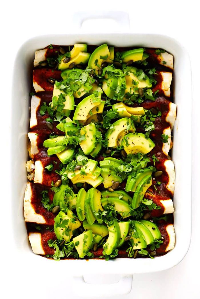 cauliflower enchiladas, with avocado, parsley on top, white casserole, healthy recipes for weight loss