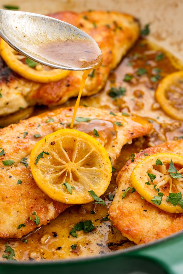 lemon pepper chicken, sauce poured on top, lemon slices on top, what to cook for dinner tonight easy, parsley for garnish