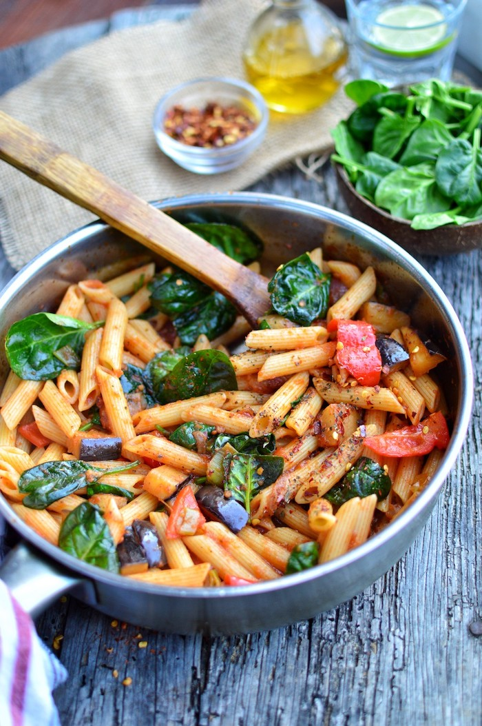 eggplant penne, with spinach and peppers, in a pot, wooden spatula, what to cook for dinner tonight easy, black wooden table