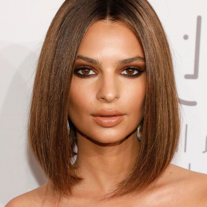 emily ratajkowski looking at the camera, brown straight hair, medium length hairstyles, white backgroundd
