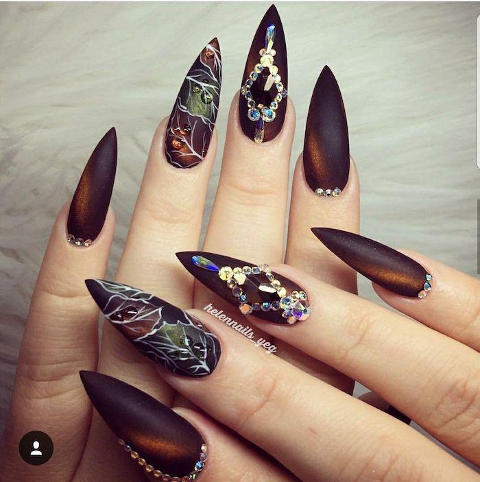 long stiletto nails, 2019 nail trends, dark orange, red nail polish, ombre nails, rhinestones and leaves, nail decorations