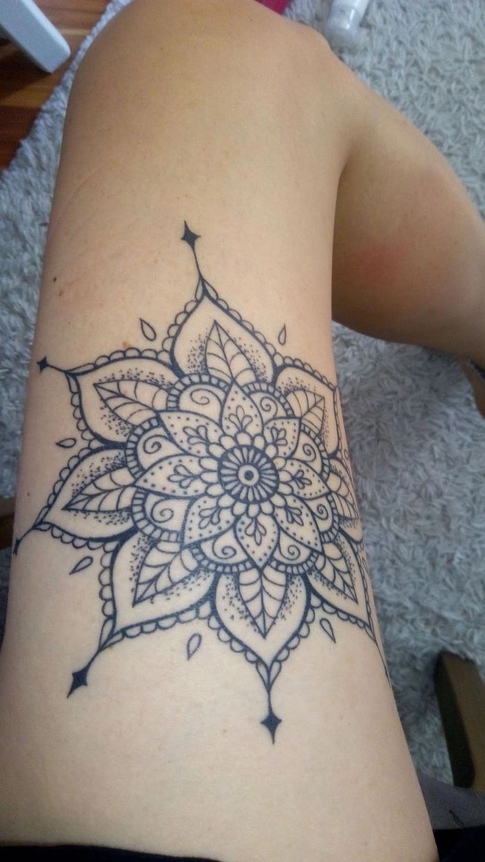 thigh tattoos for girls, mandala flower tattoo, white carpet, wooden floor