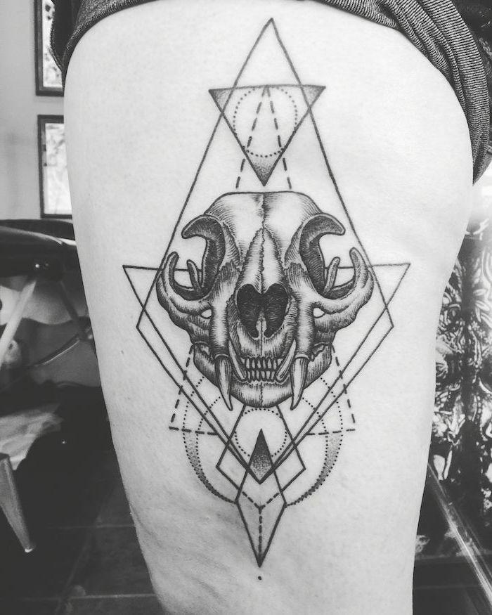geometrical design, animal skull, thigh tattoos for girls, black and white photo