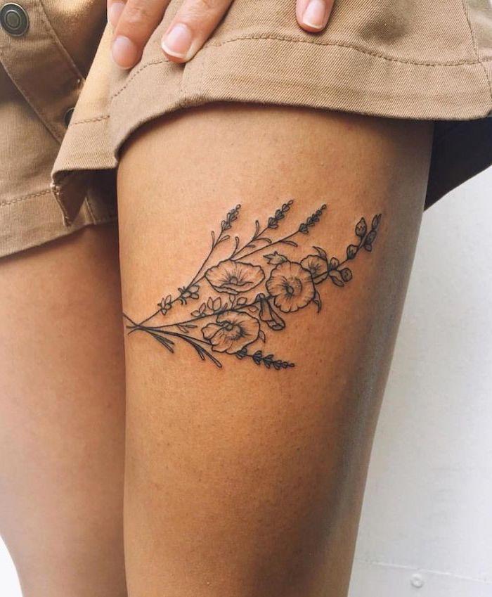 beige denim shorts, tattoo ideas for women, small floral tattoo, three poppies