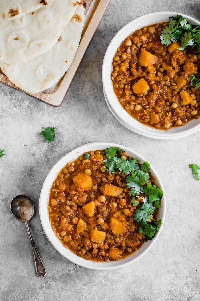 pita on wooden tray, white bowls, best weight loss diet, butternut squash, lentil stew