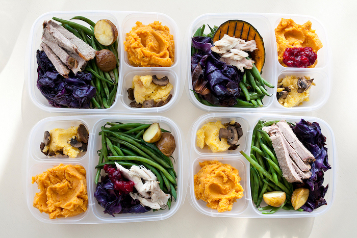 healthy meal prep ideas, four plastic containers, with meat and beans, butternut squash, cabbage and potatoes