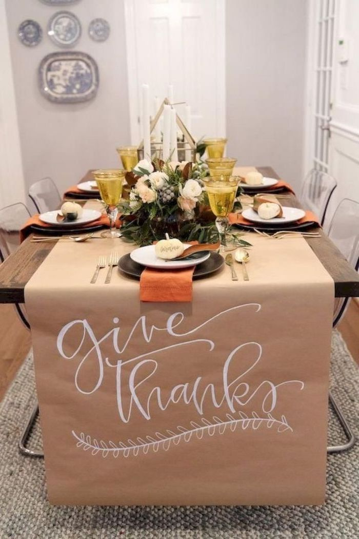 give thanks, table runner, outdoor thanksgiving decorations, yellow wine glasses, wooden table, plate settings, flower arrangement