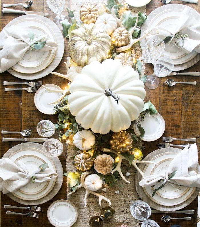 big white pumpkin, smaller pumpkins, painted gold, arranged as table runner, outdoor thanksgiving decorations, wooden table
