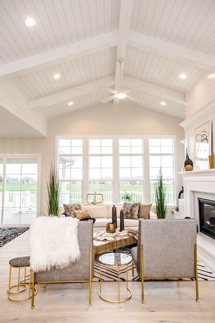 white aesthetic, grey armchairs, brass side tables, vaulted ceiling ideas, tall windows, wooden floor