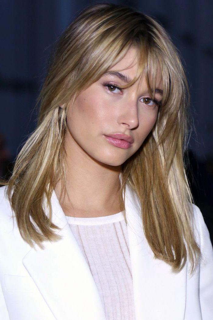 hailey baldwin, blonde hair with bangs, wearing white blazer and blouse, shoulder length bob
