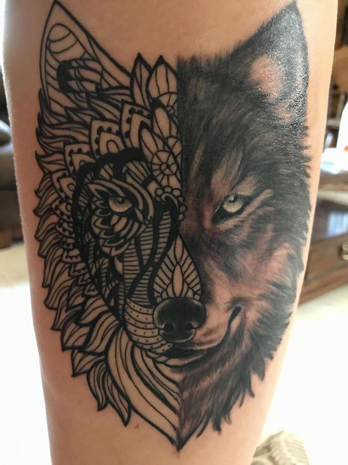 thigh tattoo ideas, half wolf, half mandala, blurred background