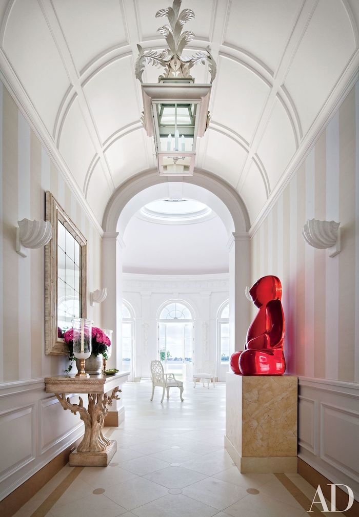 barrel ceiling, white hallway, vaulted ceiling lighting, pink roses, flower bouquet, pink glass teddy bear