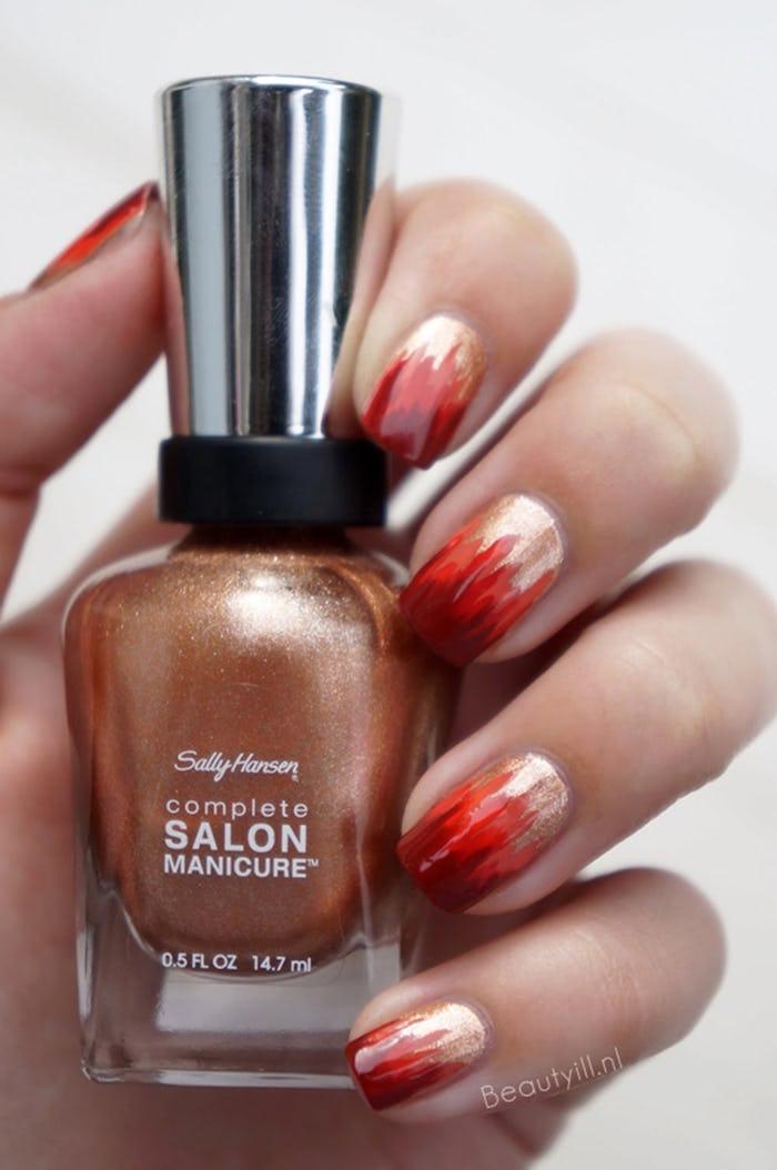 gold glitter, nail polish bottle, red and orange flames, nail decorations, autumn nails, white background