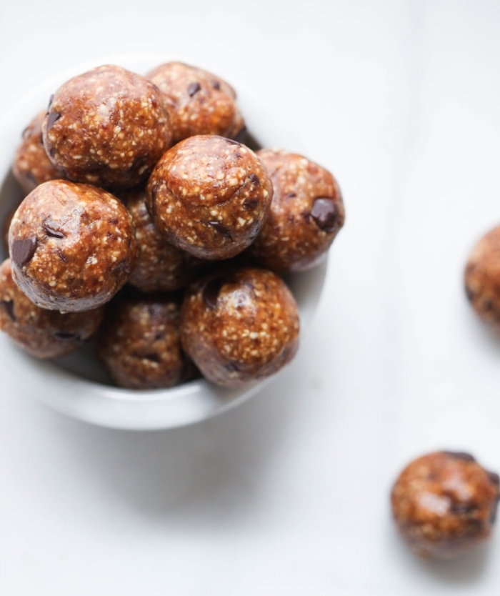 white table, peanut butter bites, with chocolate chips, power balls recipe, in white bowl