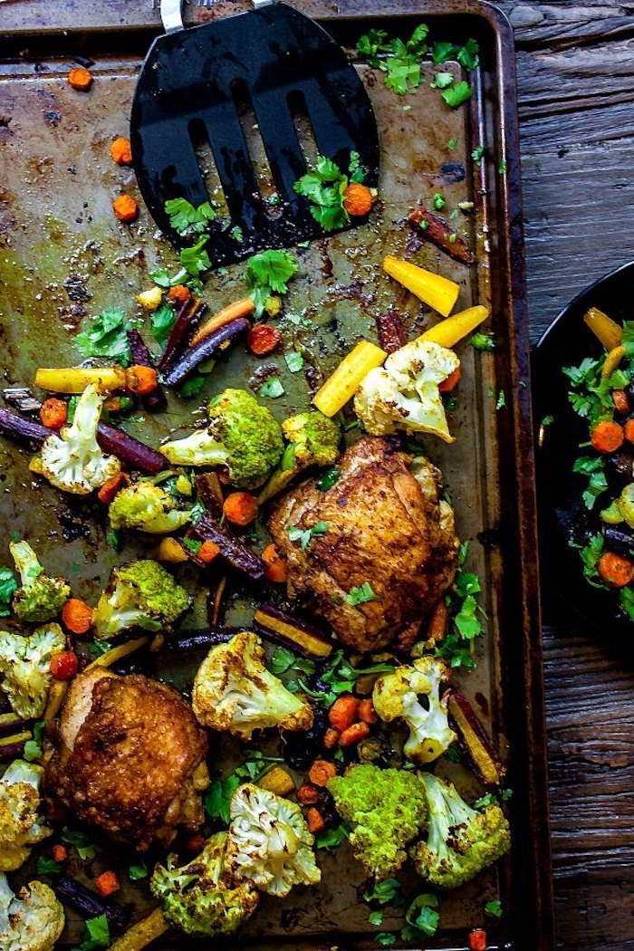 chicken with vegetables, cauliflower and broccoli, carrots and cabbage, sheet pan, wooden table, weight loss meal plan