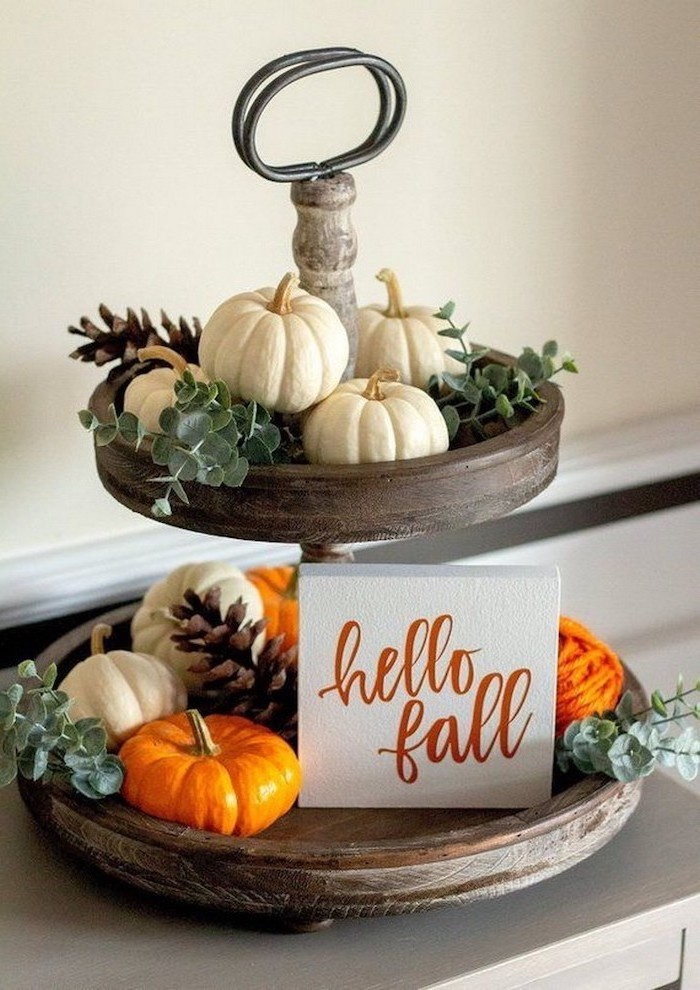 hello fall, wooden cake stand, small pumpkins, pine cones, arranged on it, outdoor thanksgiving decorations
