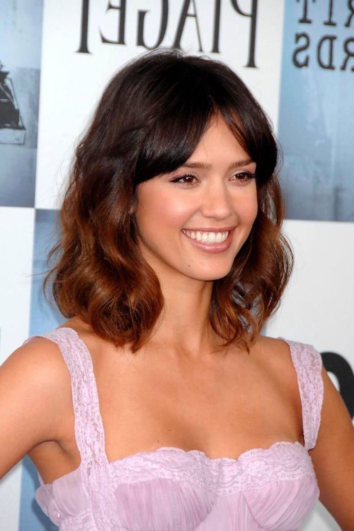 jessica alba smiling, wearing pink dress, shoulder length bob, brown hair with bangs, split in the middle