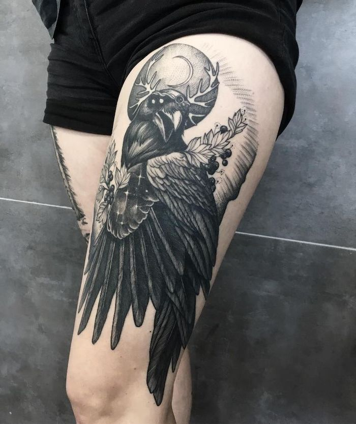 leg tattoos for women, black crow, with flowers, full moon, black shorts, black background