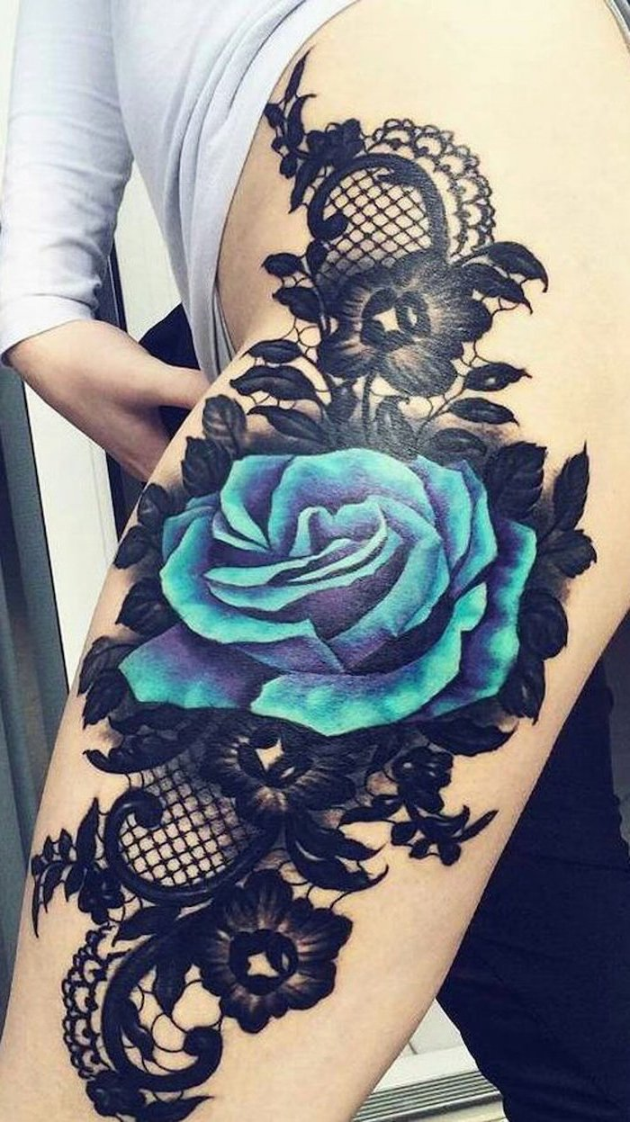 large blue rose, black flowers, black lace, white blouse, black pants, thigh tattoo ideas