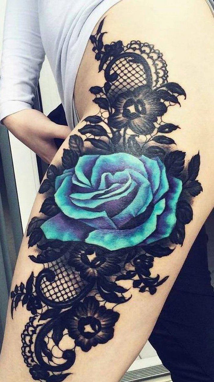 large blue rose, black flowers, black lace, white blouse, black pants, thigh tattoo ideas