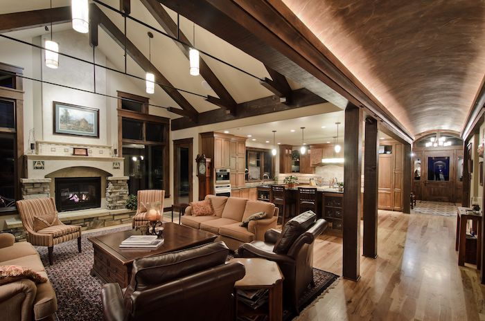 what is a vaulted ceiling, barrel ceiling, in the hallway, brown leather armchairs, beige sofas, wooden table