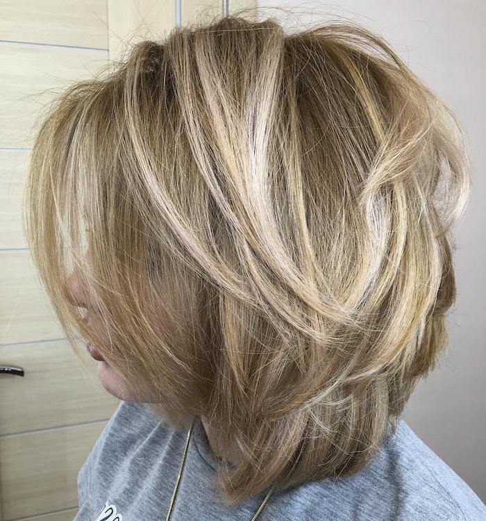 blonde hair with blonde highlights, hairstyles for medium length hair, woman wearing grey blouse