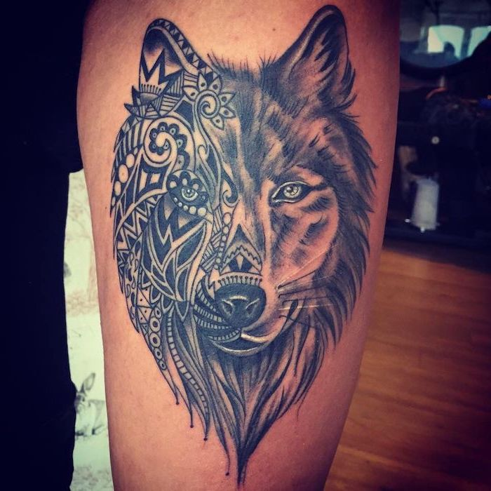 half wolf, half mandala, wooden floor, thigh tattoo ideas, black pants