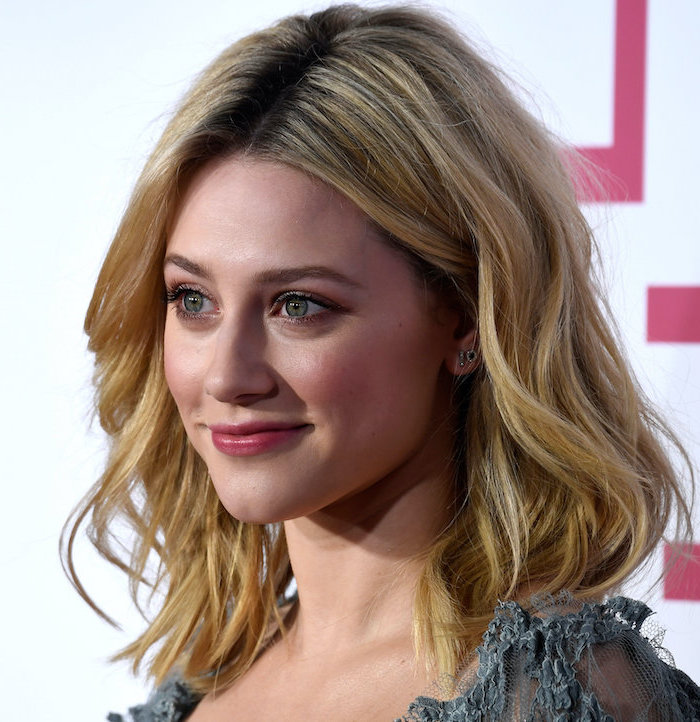 hairstyles for medium length hair, lili reinhart, wearing grey lace tulle dress, blonde wavy hair