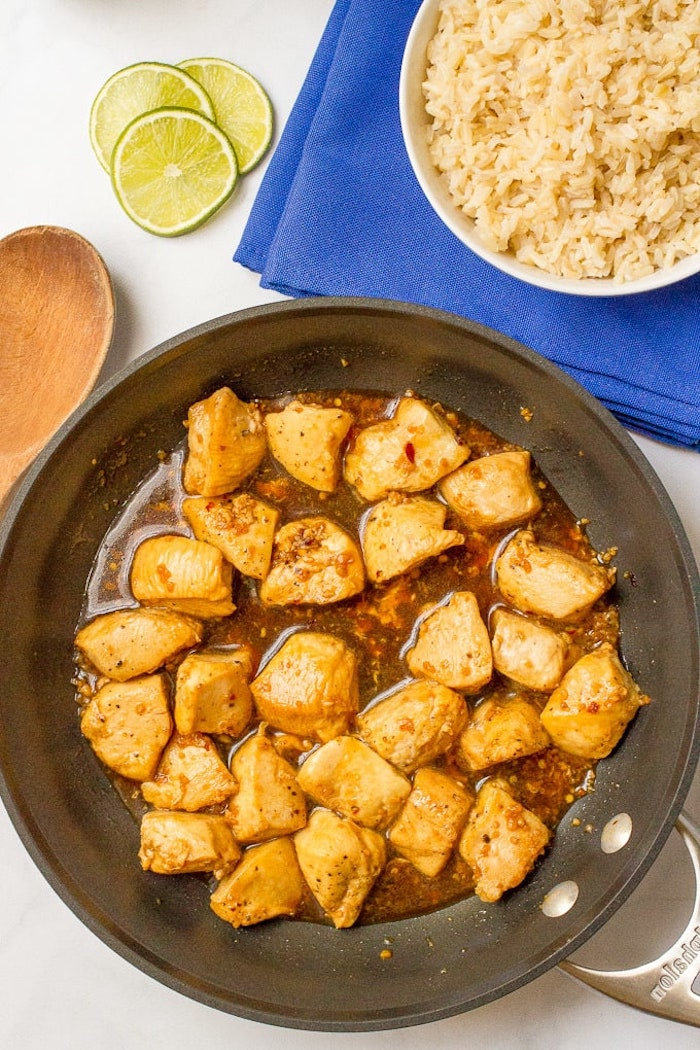 rice in white plate, on blue cloth, easy weeknight dinners, honey garlic chicken, cooked in skillet, lime slices