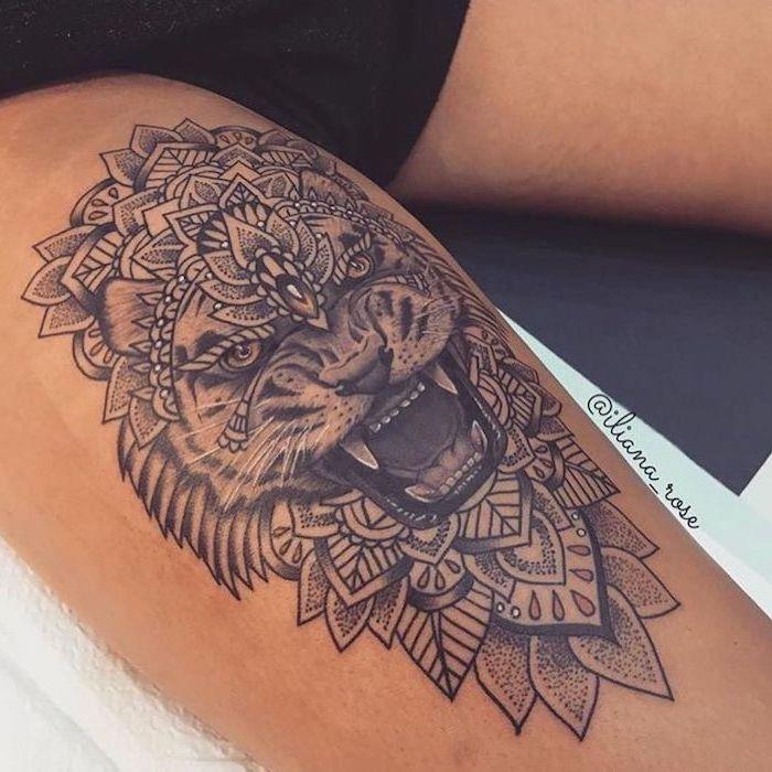 mandala tattoo, lion roaring, leg tattoo ideas, black shorts, white paper napkins