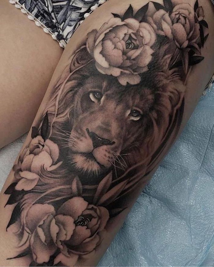 lion head, surrounded by flowers, leg tattoos for women, black and white shorts