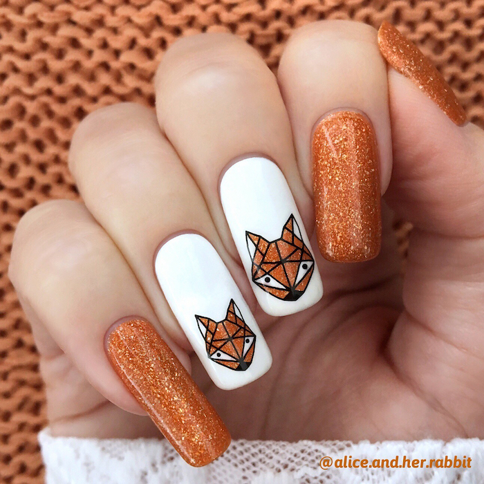 orange glitter, white nail polish, glitter foxes, nail decorations, fall nail ideas, long squoval nails