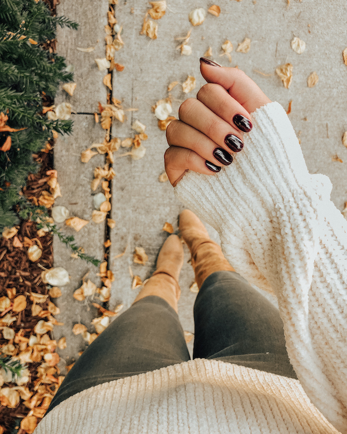 black and white, red marble, nail polish, fall nail ideas, white sweater, beige velvet boors, fall leaves