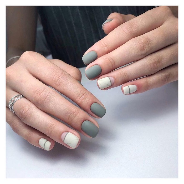 neutral nail colors, grey and white, matte nail polish, short squoval nails, white table, silver rings