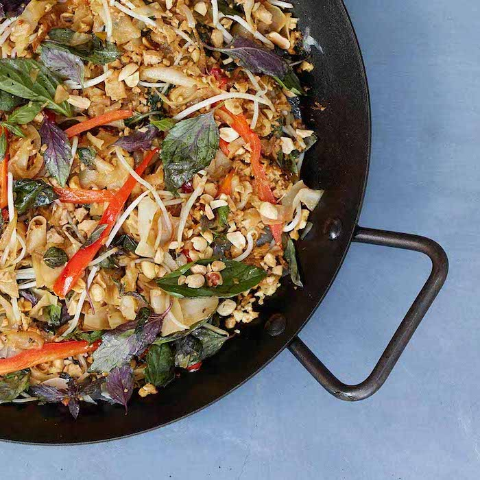 stir fry, in a black skillet, foods that help you lose weight, pasta with basil, nuts and peppers, basil leaves
