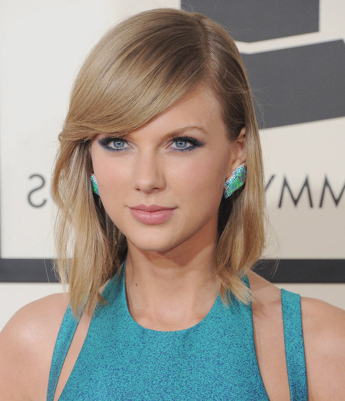 taylor swift, wearing blue dress, large earrings, blonde hair with side swept bangs, hairstyles for women