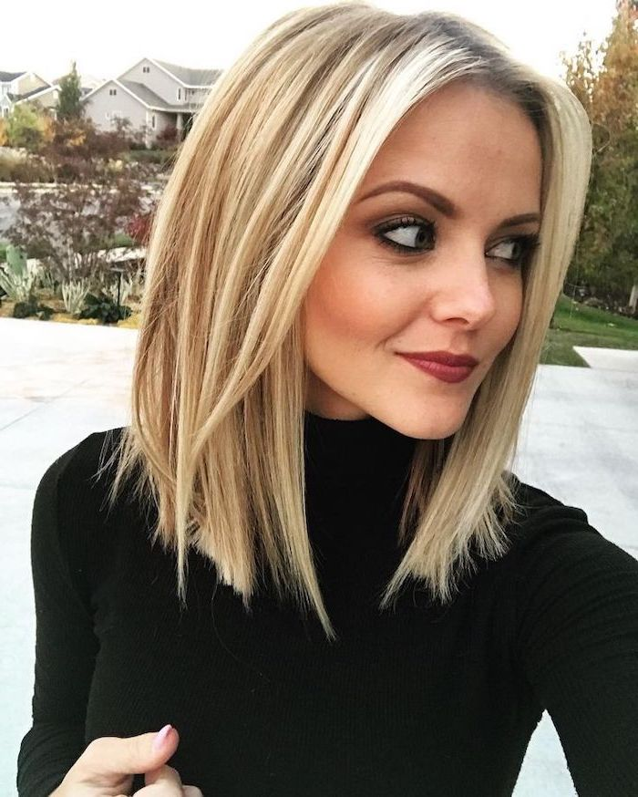 woman with blonde hair, wearing black polo blouse, medium length haircuts for women