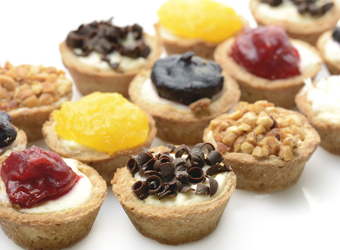 mini cheesecakes, thanksgiving cake ideas, chocolate shavings, cranberry jam, crushed peanuts, on top