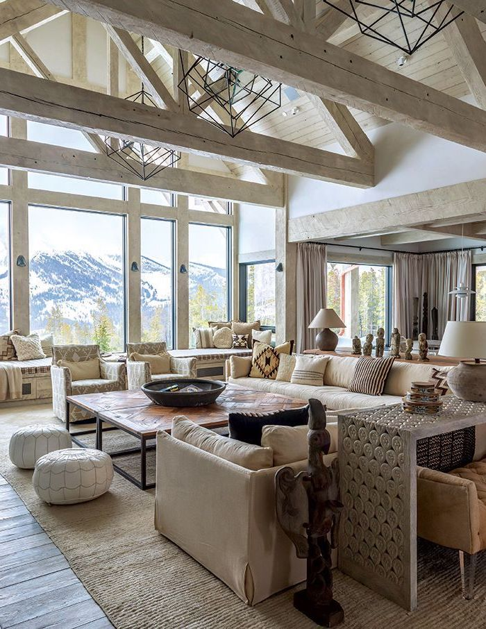 tall windows, mountain landscape, what is a vaulted ceiling, wooden floor, white sofas, wooden table