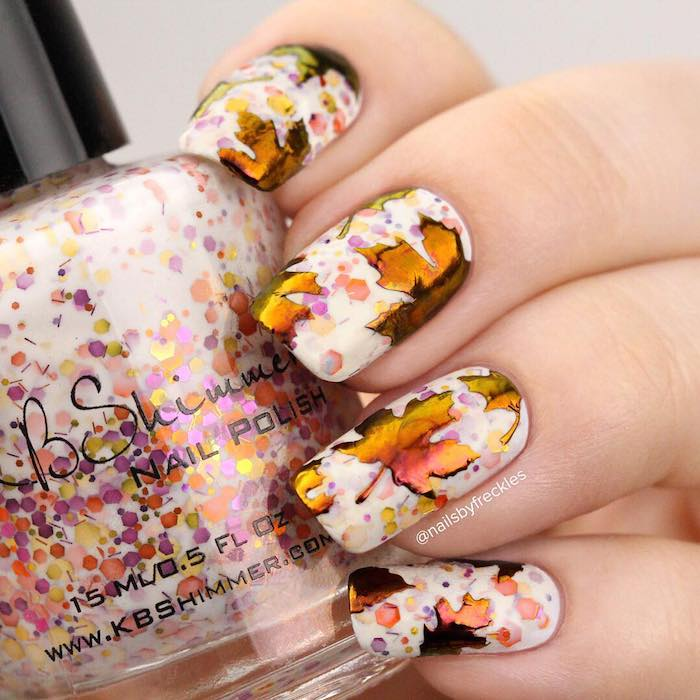 white nail polish, colorful glitter, watercolor fall leaves, nail decorations, neutral nail colors, nail polish bottle