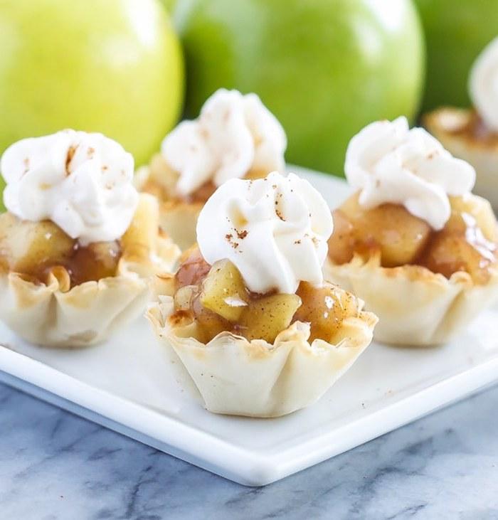 no bake, apple pie bites, thanksgiving cake ideas, cream on top, white plate, marble countertop