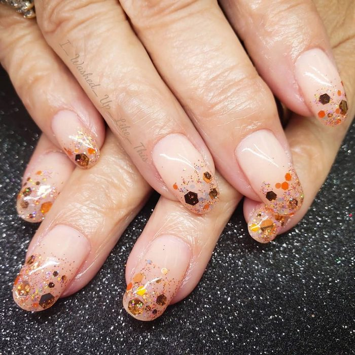 nude nail polish, cute fall nails, gold and orange glitter, long squoval nails, black glitter table