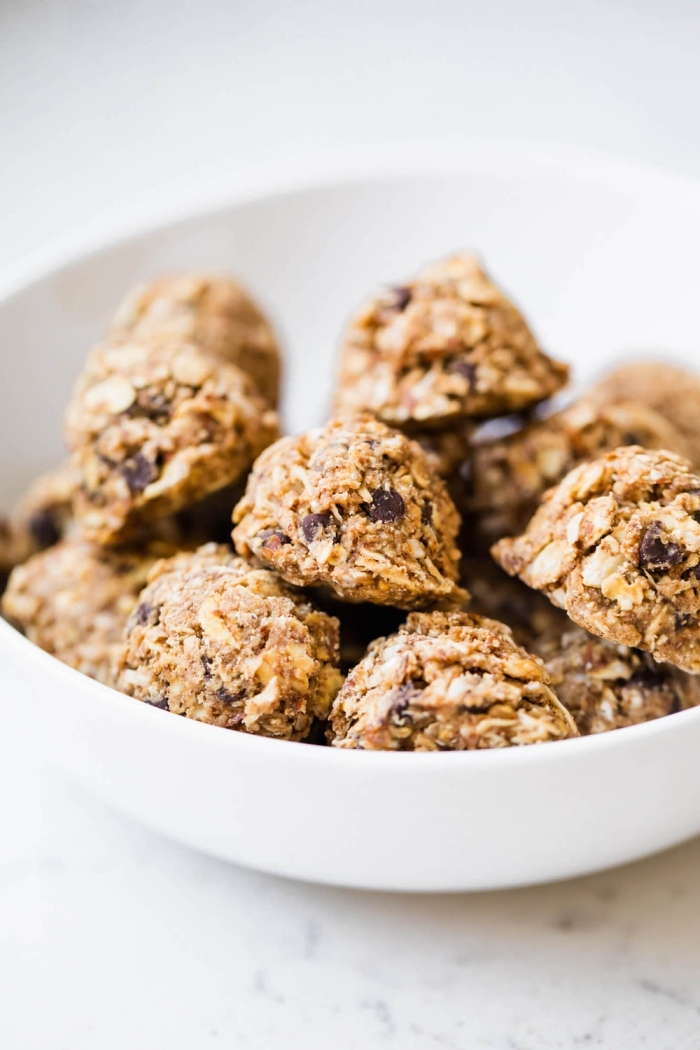 oatmeal bites, with chocolate chips, in a white bowl, protein ball recipe