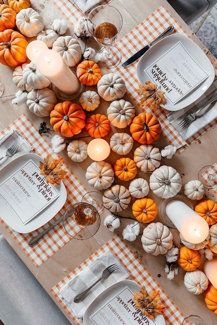pinterest thanksgiving, small pumpkins, arranged as table runner, candles between them, plate settings, wooden table