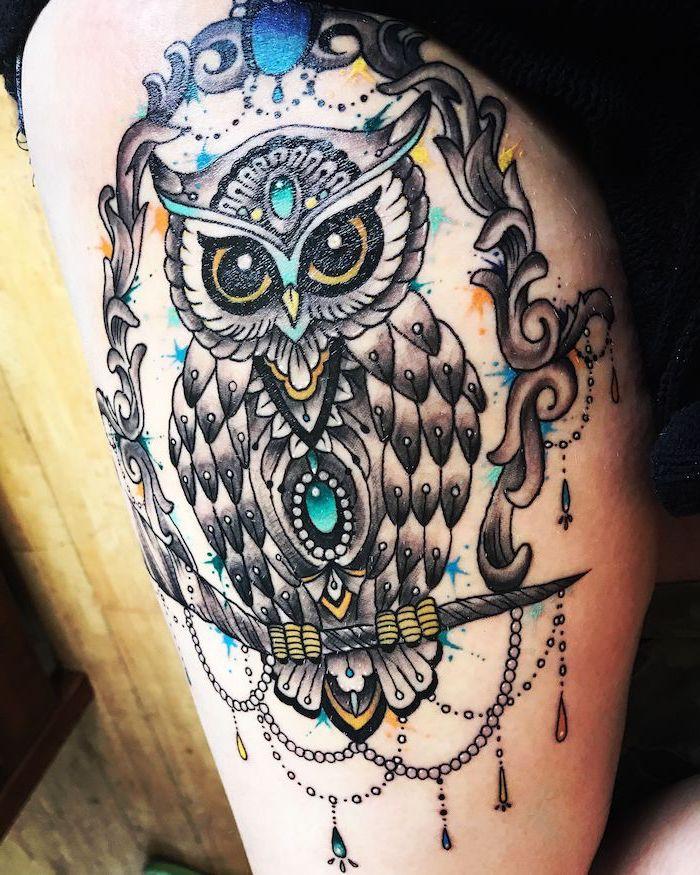 colored tattoo, large owl, leg tattoo ideas, inside a frame, wooden floor